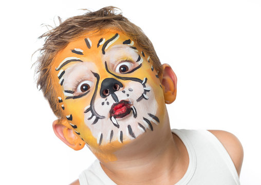 lovely adorable kid with paintings on his face as a tiger or lio