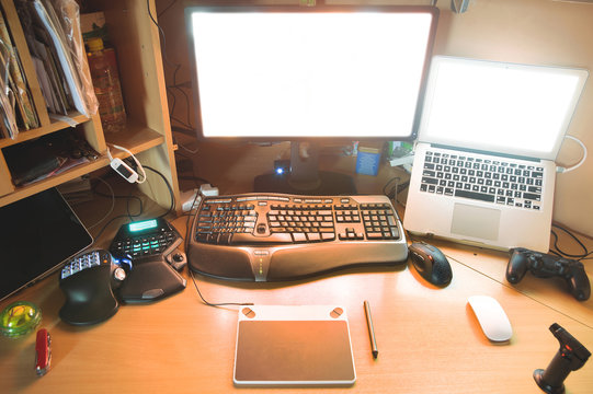 workspace of a digital artist. different light shemes. realistic lifestyle photography