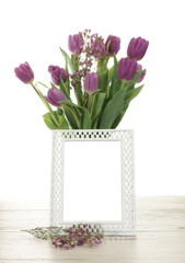 Vase of Tulip Flowers Behind a Blank Picture Frame