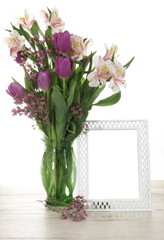 Vase of Flowers Next to Blank Picture Frame