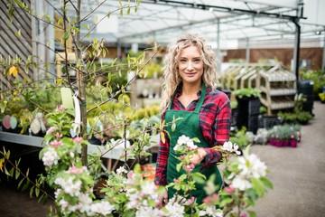 Female florist standing in garden centre