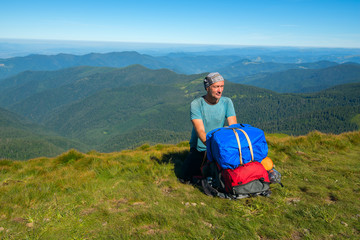 Hiker sitting on a mountain pass