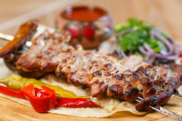 Beautiful meat dish on a wooden background