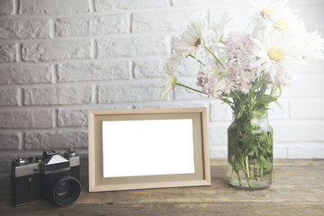 photo frame,flowers and camera