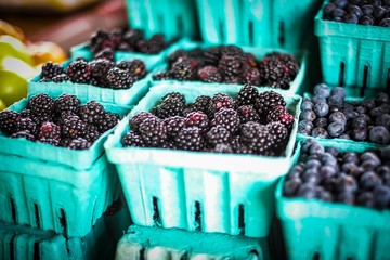 Fresh Picked Blackberries and Blueberries in Containers at Farmers Market