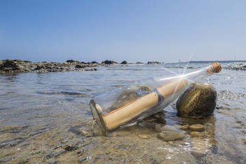 Message in a bottle on the beach of Tarifa, Spain.