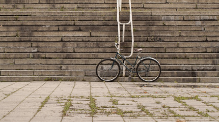 Deurstickers Fiets Fixed gear black retro style bicycle standing on old urban vintage street against stairs background