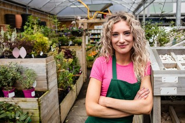 Portrait of female florist standing with arms crossed
