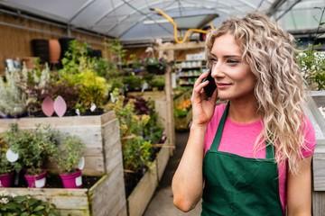 Female florist talking on mobile phone