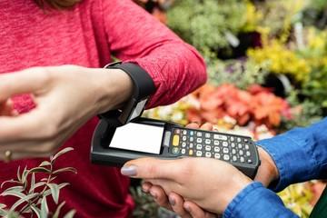 Woman making payment through smart watch