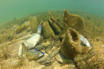 Plastic ocean pollution. Bottles, bags, cans and other rubbish thrown into sea causing environmental problems.