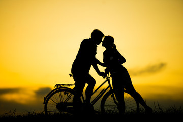 sillhouette couple love. kissing at beautiful sunset time.