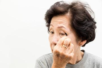 old woman applying make up,asian people, asian women