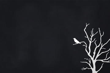 raven on tree with chalkboard background