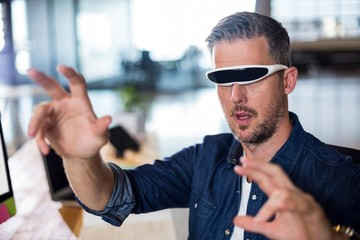 Man wearing virtual glass in office
