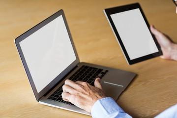 Cropped image of man working on laptop