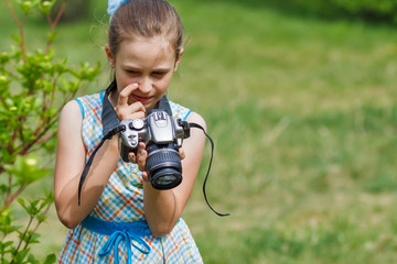 Girl photographer at green meadow