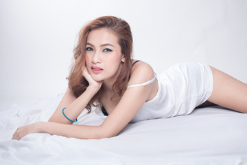 Portrait of a beautiful young asian woman in bed