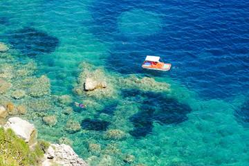 Diver doing snorkeling in the blue waters in Greece. Corfu islan