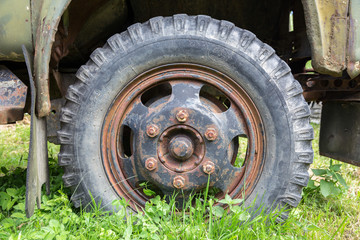 Close-up view of a wheel of an old soviet truck