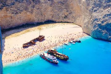 Boats anchored at Navagio beach, Zakynthos. Famous shipwreck on