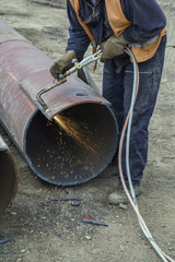 Worker cutting metal with flame torch 3