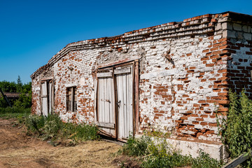 Abandoned brick cowshed