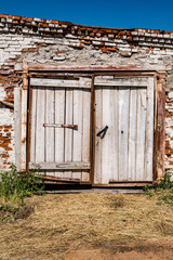 Wooden gates of an abandoned barn