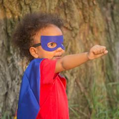 Black baby in superhero costume.