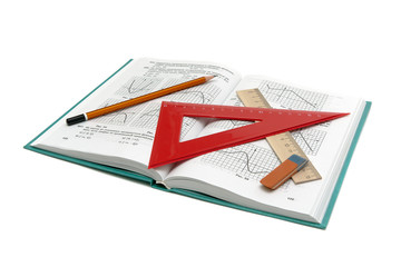 math book and office supplies on a white background