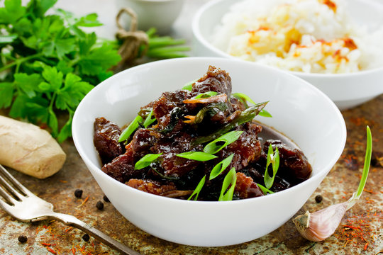 Mongolian meat - beef in dark spicy sauce in asian style