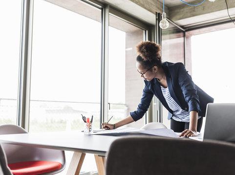 Working businesswoman in office
