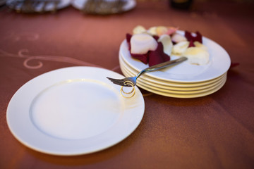 image of wedding day rings on forks
