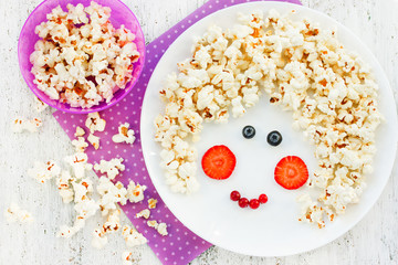 Fun food art idea for positive food with popcorn and berries