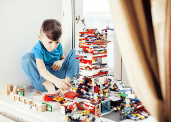 little cute preschooler boy playing lego toys at home, lifestyle children concept