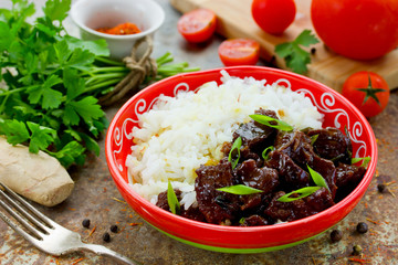Mongolian meat in sauce with rice