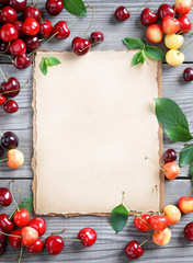Healthy eating concept. Open recipe book with Cherries on wooden table. Copy space for your text. Top view, high resolution product.