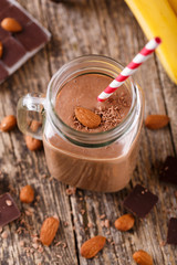 Detox chocolate smoothie with nuts in glass jar.