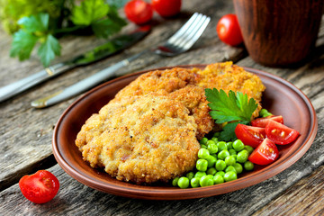 Delicious and hearty meal - fried steak in bread crumbs