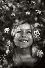 Portrait of young girl, outdoors, smiling, black and white
