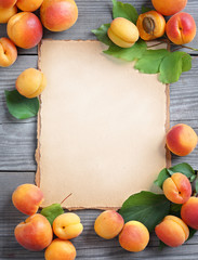 Healthy fruits background. Open recipe book with fresh apricots on wooden table. High resolution product. Copy space for your text.