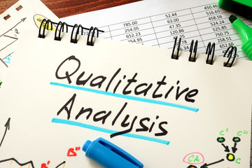 Sign Qualitative Analysis on a notepad and marker.