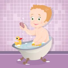 Cute baby boy smiling while talking a bath in bathroom