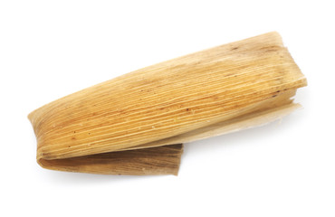 Isolated Mexican tamale on a white background.
