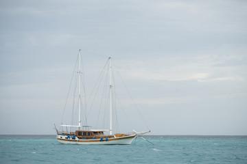 a sailboat mooring in Maldives