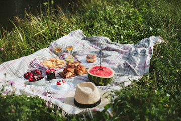 Aluminium Prints Picnic summer picnic on the rug. Fruits, berries, pastries and cheese