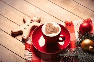 cup of coffee, gingerbread man and christmas decorations