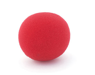 Isolated red foam clown nose on a white background.