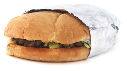 Isolated Mexican torta sandwich on a white background.