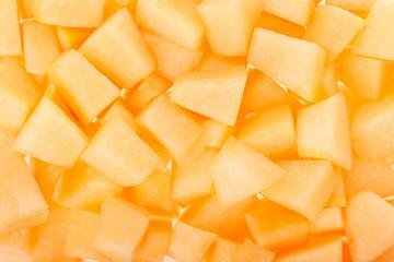 Cantaloupe melon chunks texture background